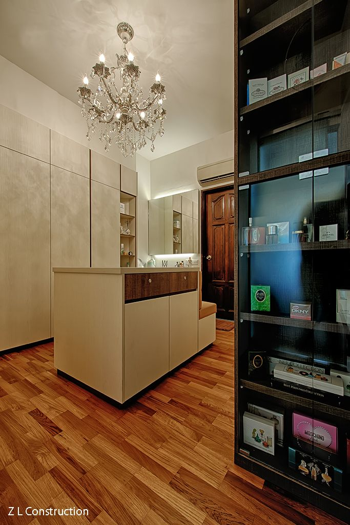 Z L Construction (Singapore) \\ Glamourous walk-in wardrobe with camel-toned plush settee, glass vanity island and ceiling chandelier.