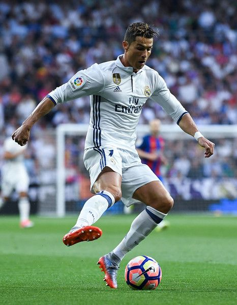 Cristiano Ronaldo of Real Madrid CF runs with the ball during the La Liga match between Real Madrid CF and FC Barcelona at the Santiago Bernabeu stadium on April 23, 2017 in Madrid, Spain.
