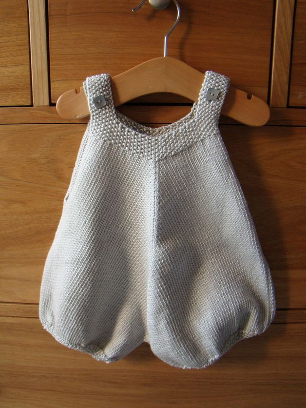 "Knitted bubble onesie / romper suit (""Barboteuse""), inspiration photo only. Elongated, roughly triangular shape. Leg cuffs worked separately, joined at the crotch, central line of decreases along the entire length of the garment (increases if worked top-down). Very nice in soft cotton yarn for summer."