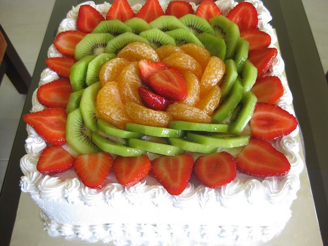 Always a tradition this cake is always around. Mexicans always have this for maybe family reunions or Birthday parties!!! CAKe Straberries Kiwis Layers NICEly arranged Rectangle Nice cut Nice use of color