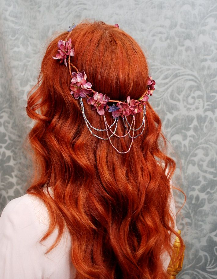 This unique floral crown features a base of woven and braided wired vines decorated with mauve millinery blossoms, navy accents, pearls, and cascades of matching beads that shimmer in the light...