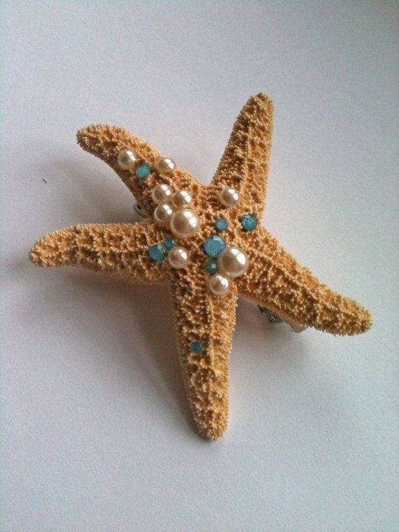 Glue rhinestones and a barette clip to a plastic seashell from Michaels