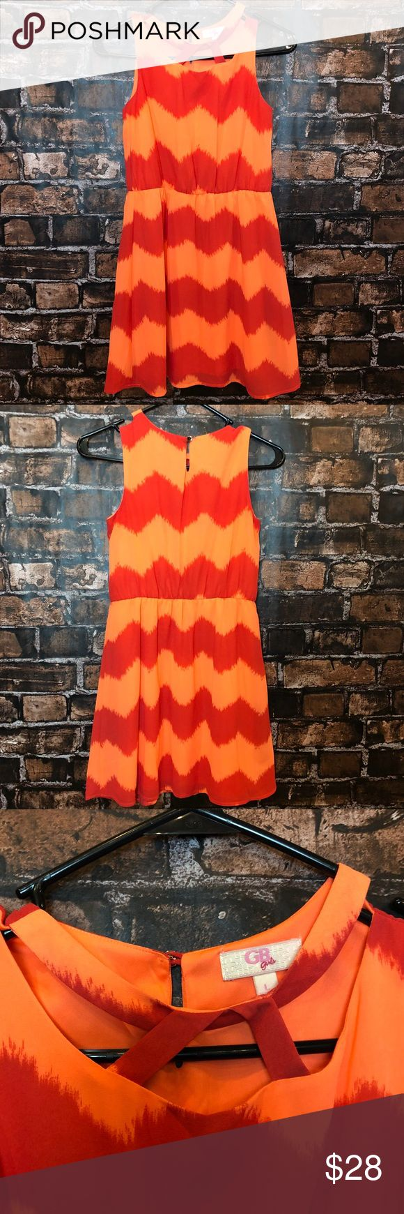 GB girls summer dress! Size L. Light/dark orange chevron dress with crisscross neck line! Like new condition. GB girl Dresses Casual