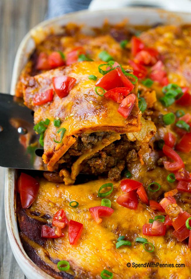 Beef Enchilada Casserole | Spend With Pennies | This beef enchilada casserole is layers of ground beef, beans, tortillas and cheese, all smothered in enchilada sauce and baked to perfection. A super easy dinner that's sure to be a crowd pleaser!