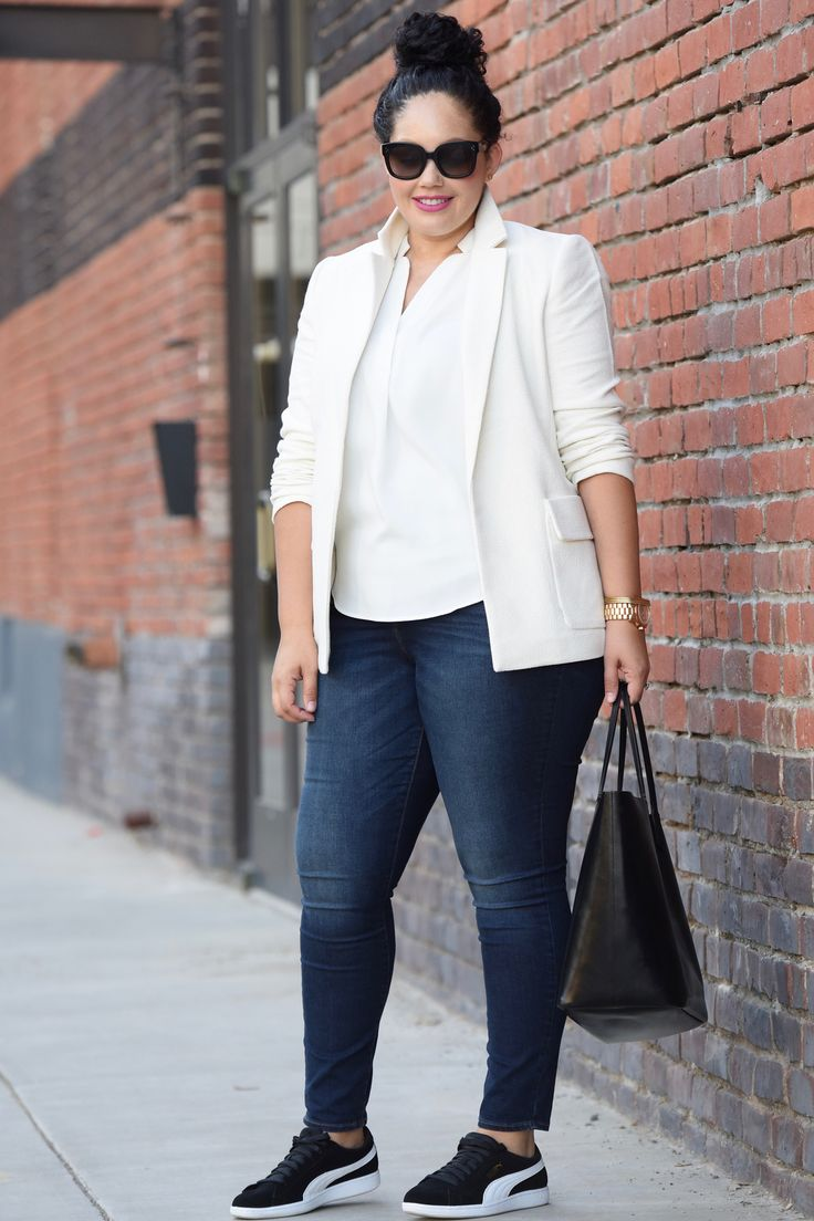 White blazer, dark denim jeans, Givenchy tote and Puma fashion sneakers worn by Tanesha Awasthi, also known as Girl With Curves.