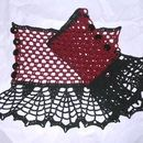 This is a gorgeous and unique pair of lace wristlets. Deep red and black complement each other in this dark gothic steampunk pair of lace gloves. You will feel elegant and beautiful wearing these...
