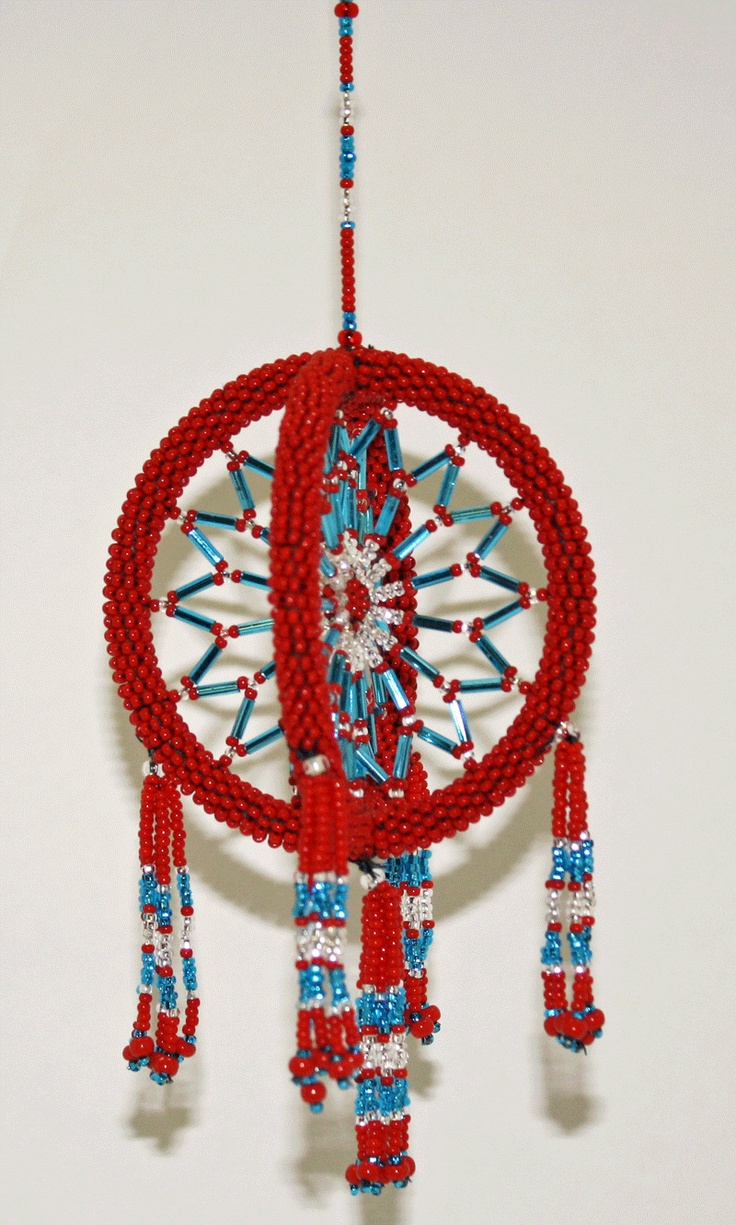 Two beaded circles entwined together with tassels. Made by Christopher Vital from Behchoko, NT. $32.50