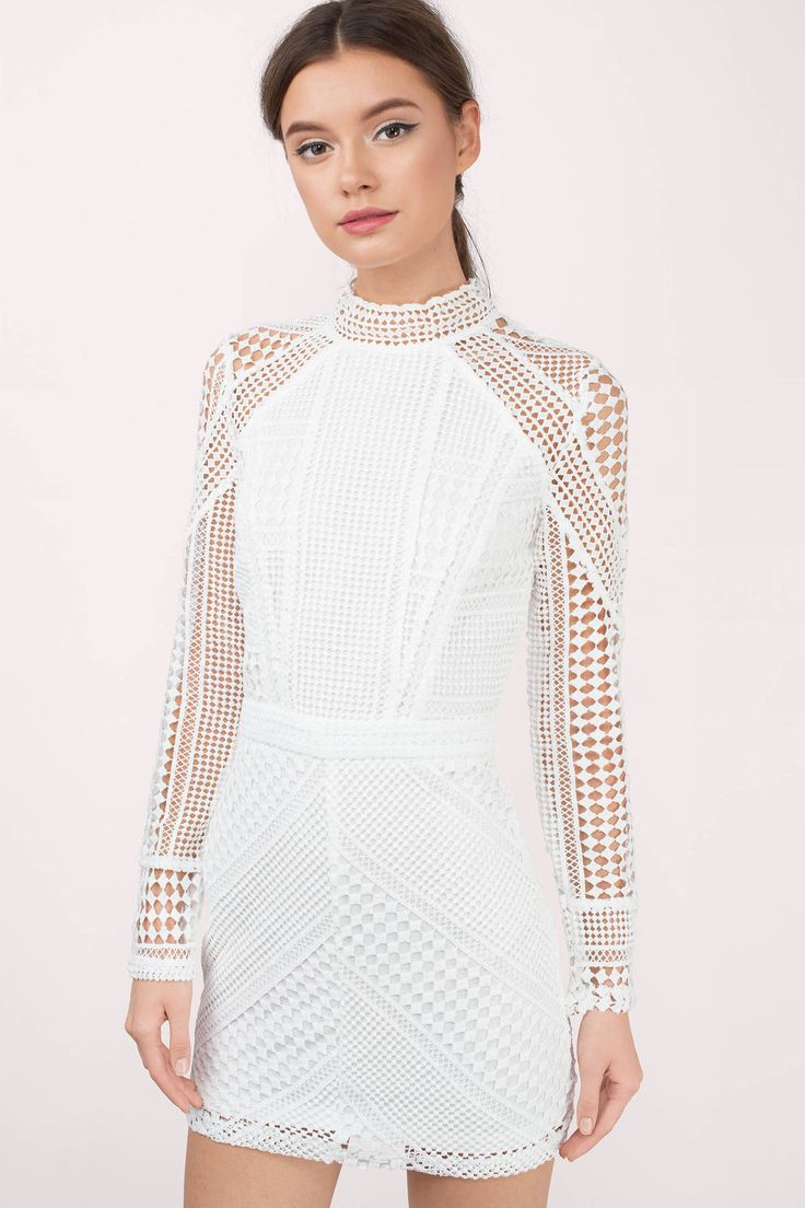 White lace bodycon dress with beautiful lace details. Pair with black heels and you're set for the day!