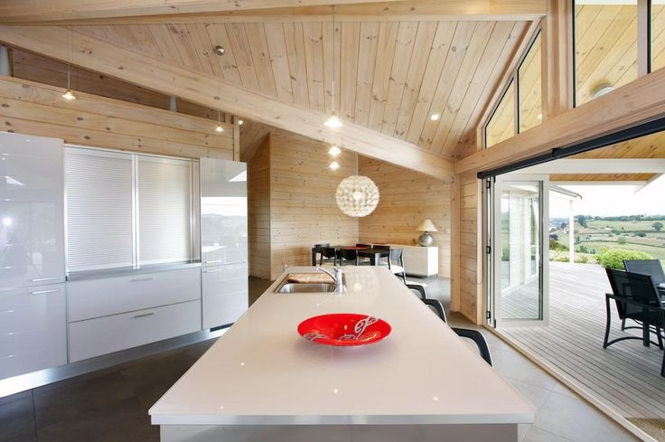 Open plan kitchen and dining area. The sliding doors off the kitchen are perfect for the indoor/outdoor feeling.