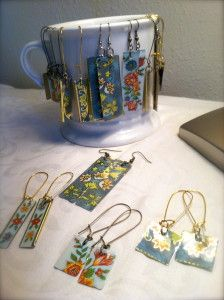 Make earrings out of pretty tin boxes. Seems pretty simple if you've got the tin! Good idea