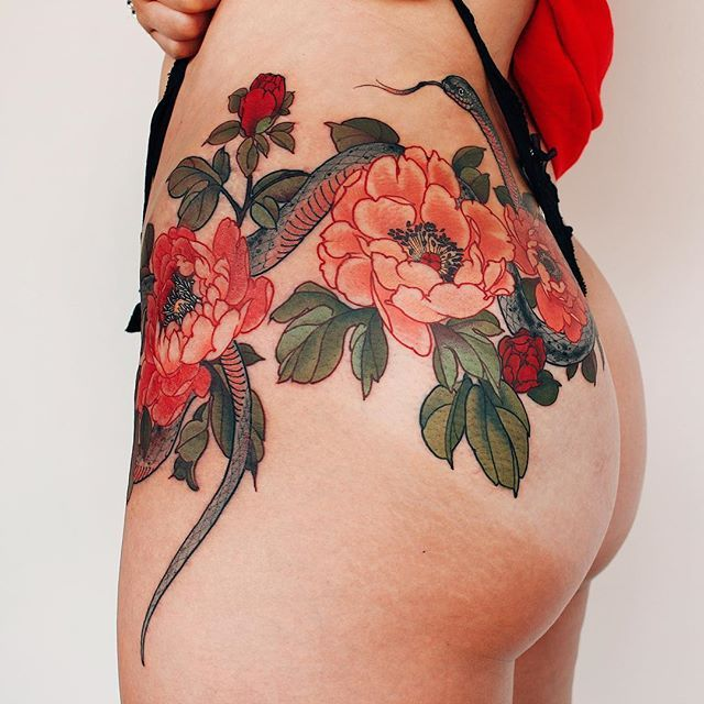 A snake and peony flowers tattoo on ass by @yuuztattooer