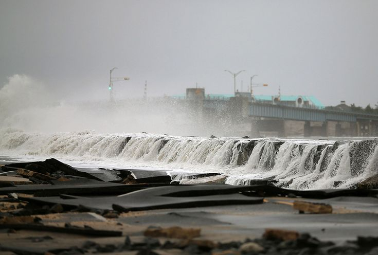 45)  Heavy surf caused by Hurricane Sandy buckled and tore up Ocean Avenue on October 30, 2012 in Avalon, New Jersey. (Mark Wilson/Getty Images)