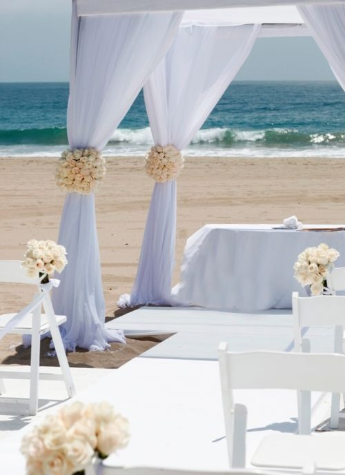 Beach Wedding With The White Garden Chairs