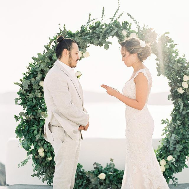 Surrounded by greenery and amazing views, Alex & Alfredo exchanged their vows 💚 . . . #santoriniwedding #santoriniglamweddings #weddingingreece #destinationwedding #destinationelopement #destinationwedding #greenerywedding #ceremonyarch
