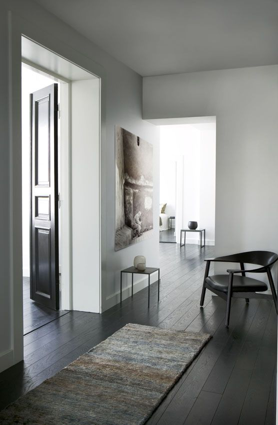 dark floors and doors with white walls. love detailed door with the simplicity of everything else