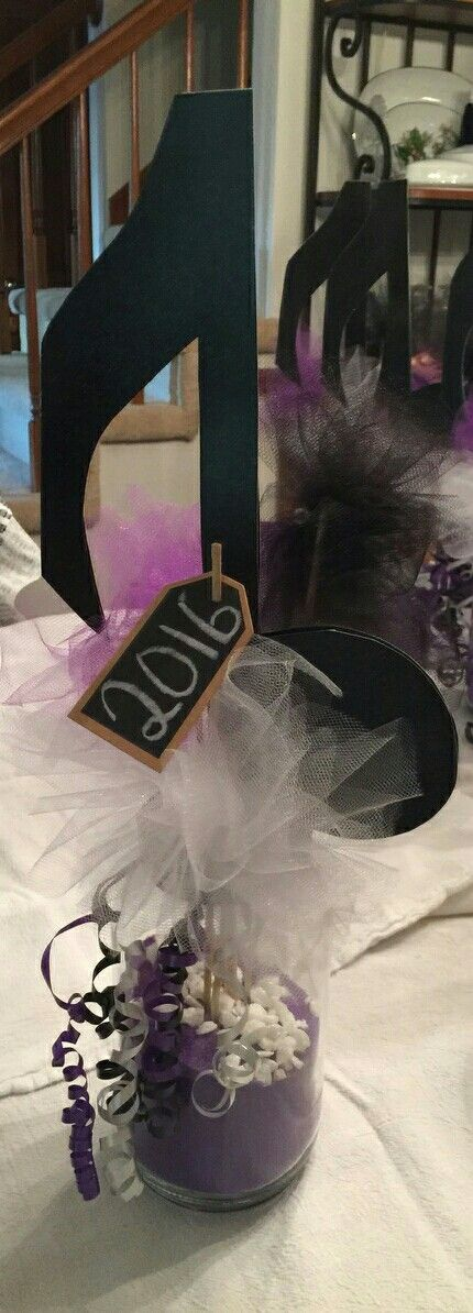 Band banquet centerpieces.  Purple sand and tulle.  Music note cut from thick construction paper and then spray painted glitter.