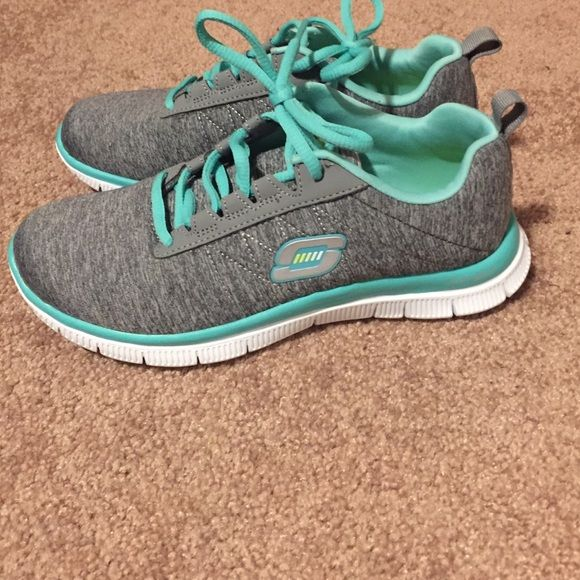 Skechers Memory Foam Lightweight Sneakers gray with mint accent memory foam shoes. true to size as I'm a 6.5 and tried to squeeze into these 6's and failed :( only worn once! make an offer! Skechers Shoes Athletic Shoes