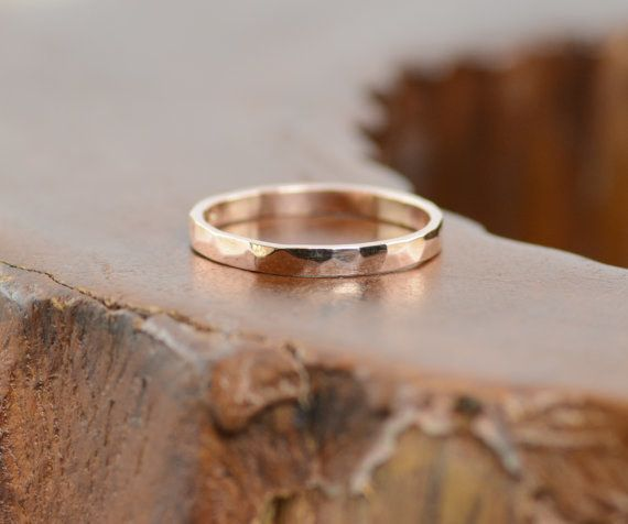 "This high-shine unisex <a href=""https://go.redirectingat.com?id=74679X1524629&sref=https%3A%2F%2Fwww.buzzfeed.com%2Falisoncaporimo%2Fput-a-rose-gold-ring-on-it&url=https%3A%2F%2Fwww.etsy.com%2Flisting%2F225852263%2Fhammered-14k-rose-gold-band%3Fga_order%3Dmost_relevant%26amp%3Bga_search_type%3Dall%26amp%3Bga_view_type%3Dgallery%26amp%3Bga_search_query%3Drose%2520gold%2520band%26amp%3Bref%3Dsr_gallery_10&xcust=3885021%7CAMP&xs=1"" target=""_blank"">rose gold band.</a>"