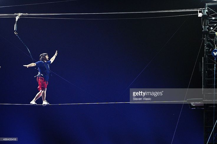 Brian 'Q' Quinn walks the high-wire at the Impractical Jokers 100th Episode Live Punishment Special at the South Street Seaport at 19 Fulton Street on September 3, 2015 in New York City.