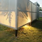 It's a fact of physics that hot air rises, and this simple concept is all Maria and Matthew Salenger needed to design a passive cooling system for the backyard pods they use as bedrooms at their house in Tempe, where the average daily temperature is 86 degrees. The light, steel-framed structures float on stilts above the yard, allowing cooler air to circulate underneath. On hotter days when this isn't enough, operable windows along the roof line and vents in the floors allow hot air to…