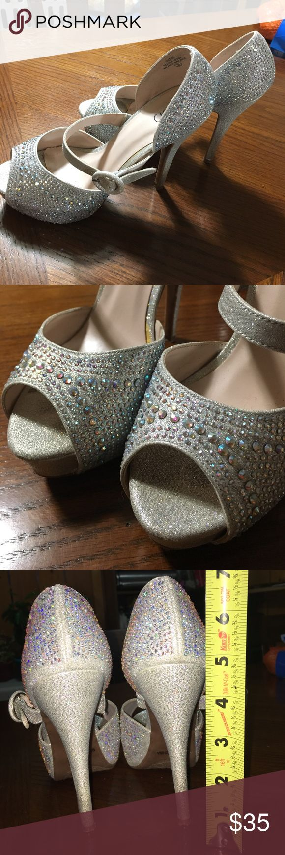 Cute Tall High Heels for Prom Sparkly heels worn for my prom. They look perfect on your foot but there are minimal signs of wear inside. Otherwise great condition! (I'm 5'1 and these added a wonderful amount of height :) ) Deb Shoes Heels