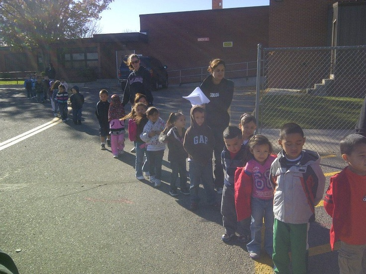 A long line of students at Rose Hill Elementary School wait to see the dentist on board the Miles for Smiles mobile dental clinic.