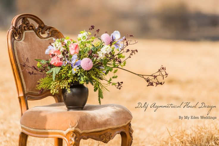 Steps for creating a rustic, asymmetrical floral design. Perfect for an entryway or dining table. #décor #DIY #floraltips #winterwedding #flowerarranging
