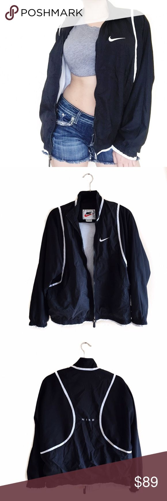 • Nike • Black Windbreaker True vintage and one of a kind Black windbreaker! Love the Nike embroidered detail to back. Mens medium/women's large. can be worn as an oversized look like shown (im a medium for reference) Nike Jackets & Coats