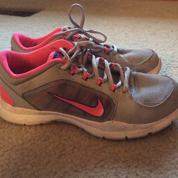 Nike training shoes, only tried on once!!! Gray, pink, and blue Nike tennis shoes worn only once. Size 8.5 Nike Shoes Athletic Shoes