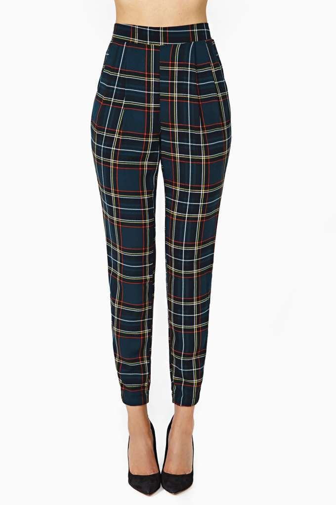 By the Book Trouser Pant @Becky Carver Gal Lightweight; hunter green trouser pants featuring a plaid print and high waist. Pockets at side; stretch band at back. Just roll up the hem and toss on your favorite tank and heels! . 100% Polyester. 27''''/68.5cm waist. 38.5''''/96.5cm length. 27''''/68.5cm inseam. 11.5''''/29cm rise. Model is wearing size small. Measurements taken from a size small. Hand wash cold. Made in USA By The Book Trouser Pant PLAID