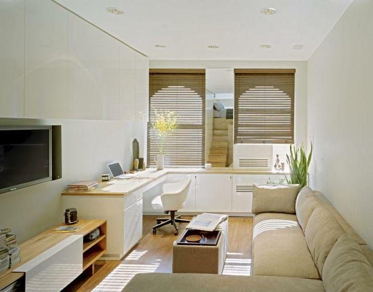 Stuen er fungerer både som tv stue, salong og hjemmekontor ...