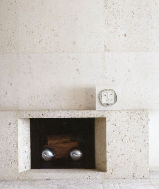 Ultramodern Samuel Marx - fireplace made of fossil stone, one of Marx's favorite materials. | Coats Homes