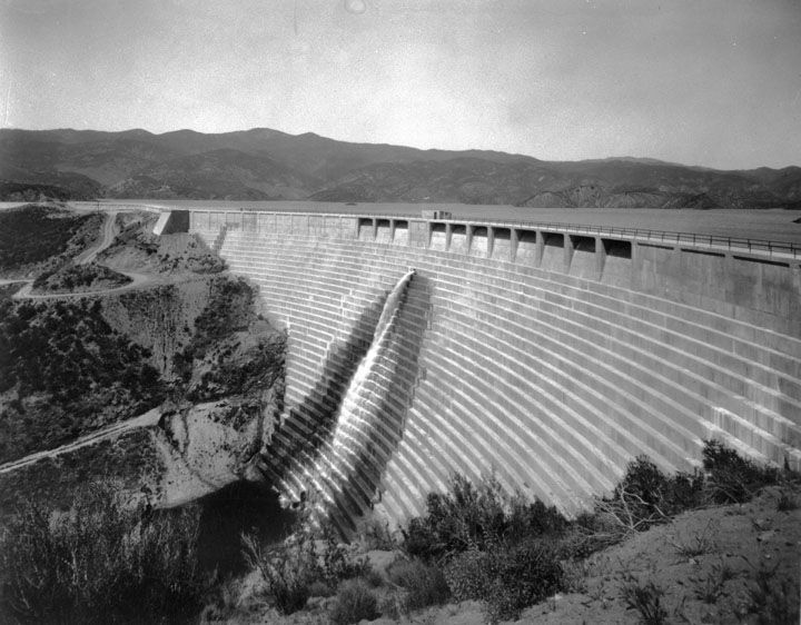 (1928)* - View of the St. Francis Dam shortly before it was filled to capacity. It took another two years before the new lake behind the St. Francis Dam would be filled by water flowing in from the Los Angeles Aqueduct.