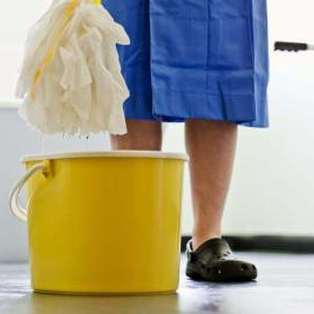 A homemade mopping solution made with vinegar brings out the shine on a vinyl floor.
