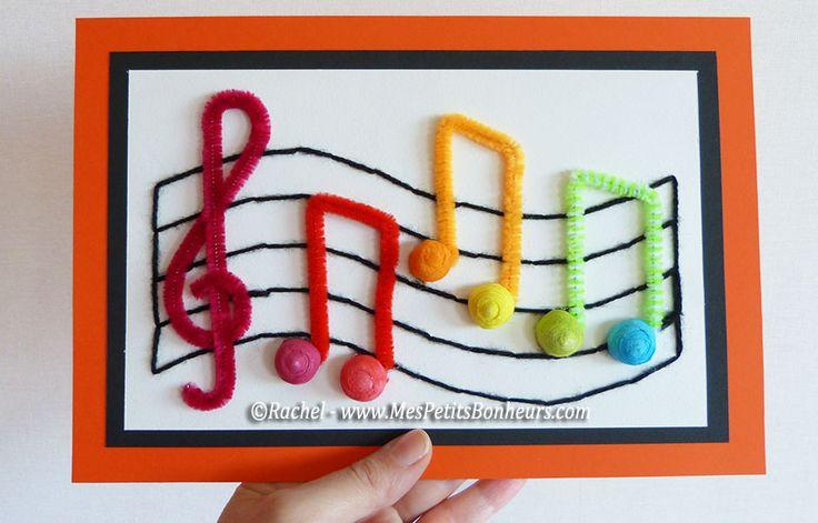 Bricolage musique pour enfants: notes arc-en-ciel sur partition brodée