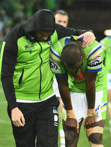 Edrick Lee of the Raiders is consoled by team mates after losing the NRL Preliminary Final match between the Melbourne Storm and the Canberra Raiders at AAMI Park on September 24, 2016 in Melbourne, Australia.