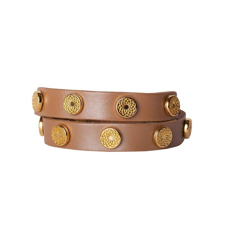 Gold tone floral studs adorn the glimmering golden surface of this fine leather wrap — making it equally perfect for casual gatherings or special occasions.  Product Material - Genuine leather with Zinc Alloy studs