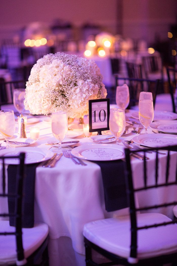 Low all white flower table centrepiece