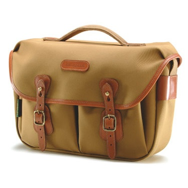 "£133.29 Billingham Hadley Pro Shoulder Bag - Khaki & Tan. Based on the immensely popular Hadley Original, the Hadley Pro has extra features; a carrying handle, a weatherproof zippered back pocket and the facility to accept AVEA pouches. The camera insert is removeable so one day it can be a roomy, well-equipped camera bag; the next it can double as a business case or a slightly posh beach bag. The Hadley Pro will accomodate A4 files and a small laptop computer. ""A British design classic"""