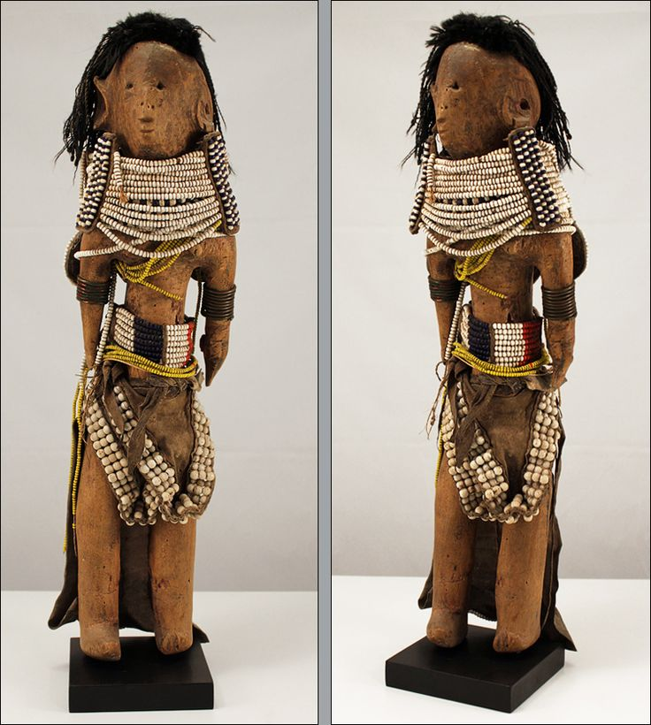 "Fertility doll ""ikoku"", Turkana, Kenya.  A large carved and lavishly decorated fertility doll dressed in traditional fashion"