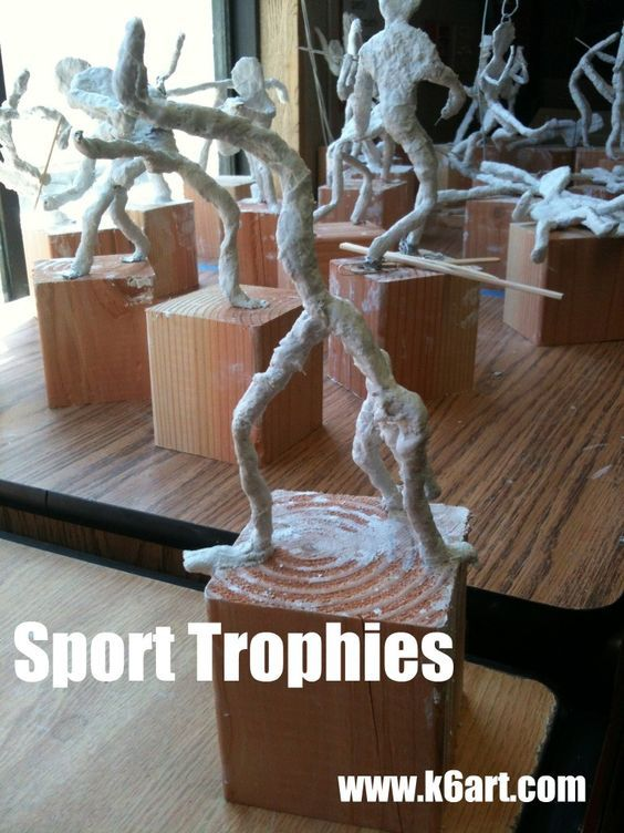Sport trophy sculptures made from wire, foil and plaster wrap. For 5th grade and older.