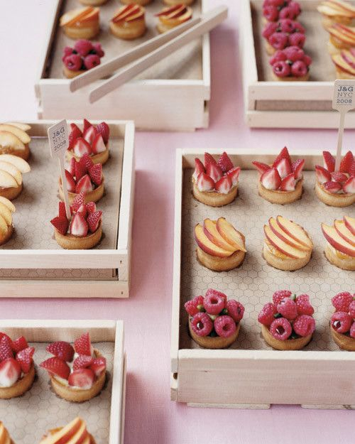 Tiny pies and tartlets were arranged in crates lined with patterned paper at Gail and Jeremy's NYC nuptials.