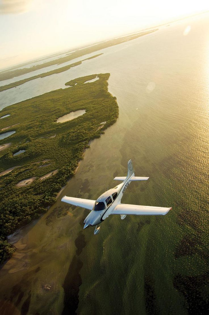 This is my dream plane, absolutely gorgeous!  Cirrus SR22.
