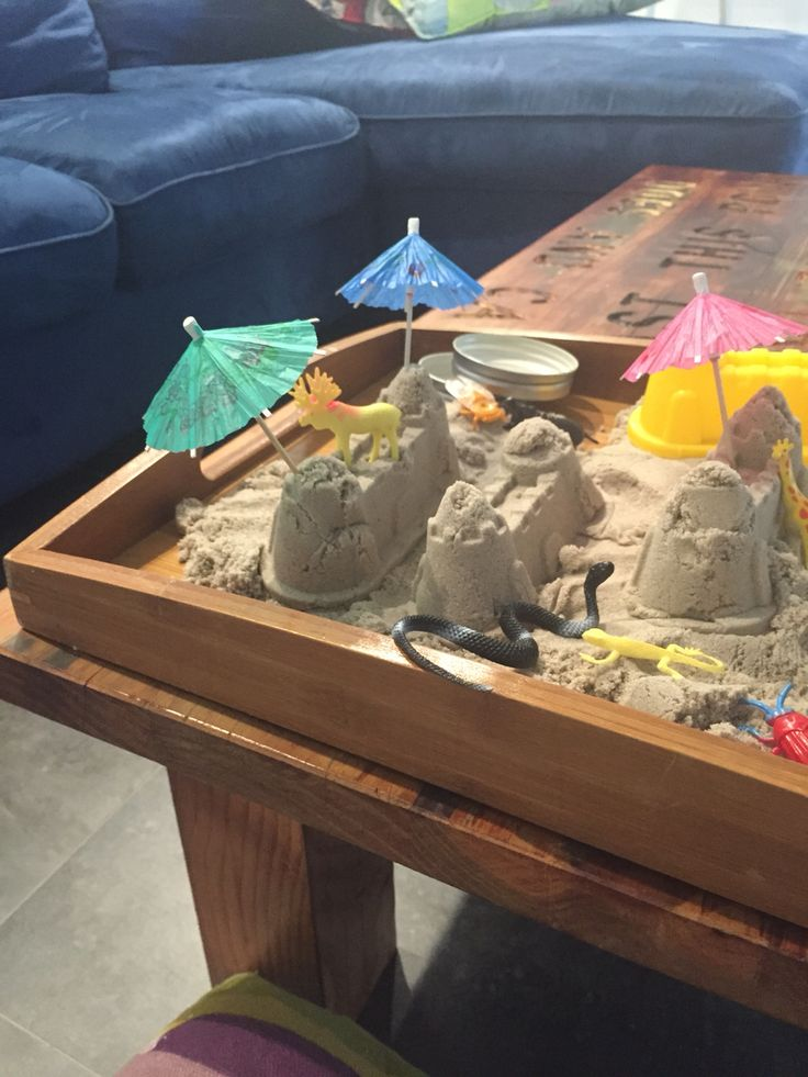 Kinetic sand and cocktail umbrellas