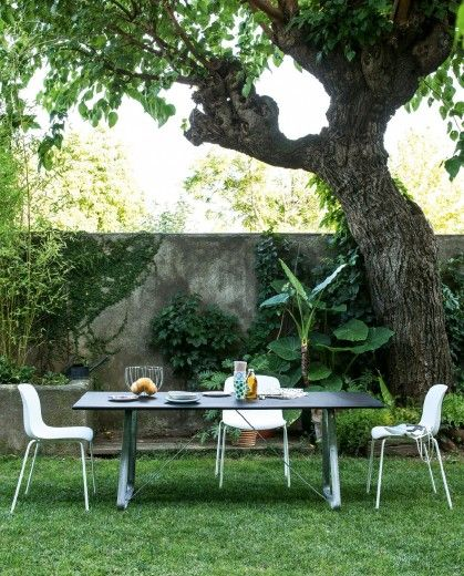 Chairs (also with arms). Frame in chromed or painted steel. Seat in beech plywood, in polycarbonate, in polypropylene or in polypropylene covered in fabric. Versions for outdoor also available.