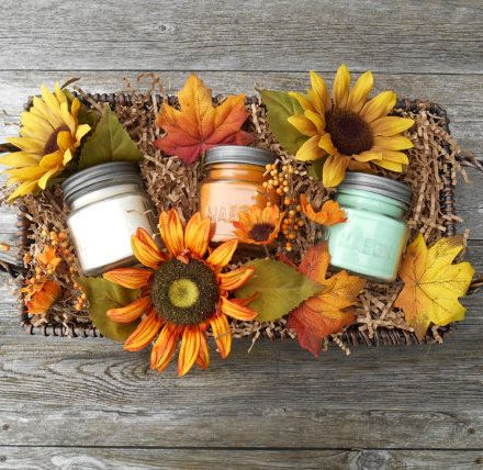 Fall gift basket:Soy Candles in a wood wick basket, decorated w/ Sunflowers + Rustic Leaves. #fllowers #autumn