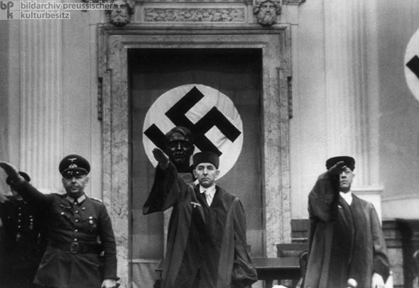 People's Court President Roland Freisler Presides over the Trial of the Participants in the July 20th Hitler Assassination  Plot (August 8, 1944) . Altogether, about 1,500 persons were arrested and 200 killed. The photo shows, from left to right, General Hermann Reinecke, presiding judge Roland Freisler, and People's Court judge Lammele, who acted as associate judge.