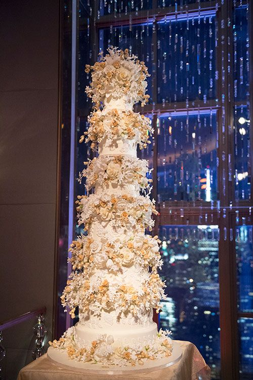 Glam NYC Wedding at the Rainbow Room, 6 Foot Tall Cake Covered in Sugar Flowers | Brides.com