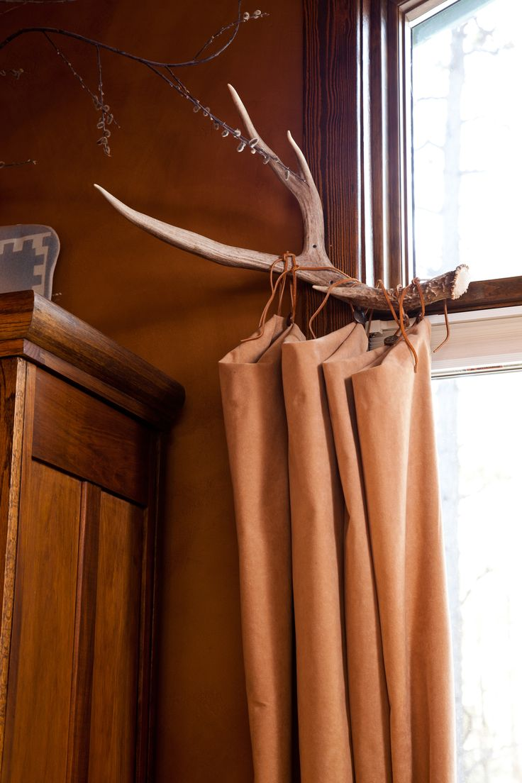 Since we live in the mountains I thought a deer horn curtain rod would be cool!