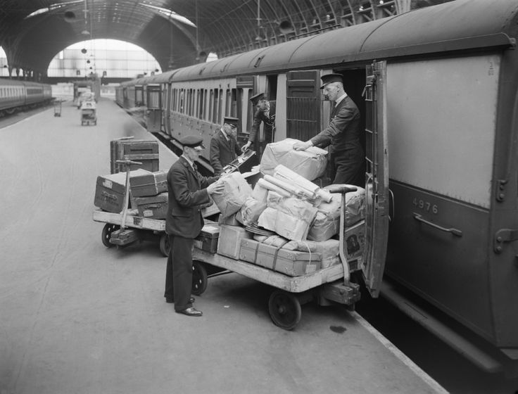 Loading luggage and parcels into a railway carriage, 1940 ...